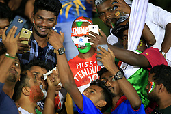 August 20, 2017 - Dambulla, Sri Lanka - Sri Lankan cricket spectators take selfie photographs with an Indian cricket supporter during the 1st One Day International cricket match bewtween Sri Lanka and India at Dambulla International cricket stadium situated in the Central Province and the first and only International cricket ground in the dry zone of Sri Lanka on Sunday 20 August 2017. (Credit Image: © Tharaka Basnayaka/NurPhoto via ZUMA Press)