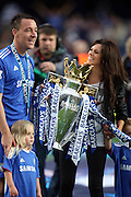 Chelsea skipper John Terry with wife Toni Poole and premiership trophy and daughter Summer Rose after they win the title with a 8-0 victory over Wigan Athletic in the English Premier League football match at Stamford Bridge, West London, England, on May 9, 2010. Chelsea finished the season one pont ahead of 2009 Champions, Manchester United.