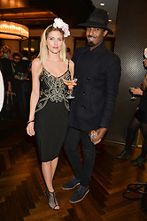 ASHLEY JAMES and MASON SMILLIE at a party to celebrate the 15th anniversary of Myla held at the House of Myla, 8-9 Stratton Street, London on 21st October 2014.