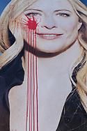 Napoli, Italia - Un cartellone rapprestentante Giorgia Meloni, leader di Fratelli d&rsquo;Italia, imbtattato da vernice rossa.<br />Ph. Roberto Salomone