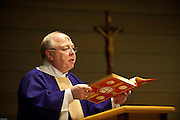 Deacon Tom Mahoney raises the Book of Gospels during Ash Wednesday Mass at UW-Green Bay's Ecumenical Center. (Sam Lucero photo)