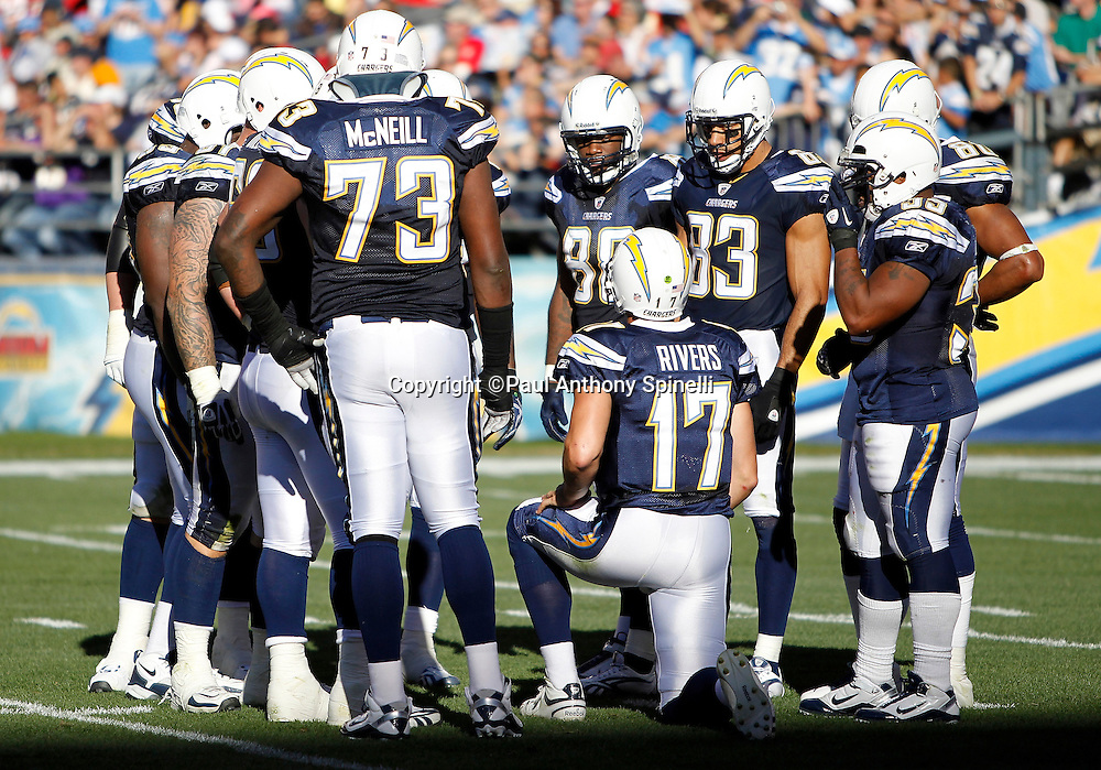 San Diego Chargers quarterback Philip Rivers (17) kneels and calls a play in the huddle during the NFL week 14 football game against the Kansas City Chiefs on Sunday, December 12, 2010 in San Diego, California. The Chargers won the game 31-0. (©Paul Anthony Spinelli)