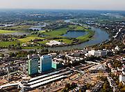 Nederland, Gelderland, Arnhem, 03-10-2010; centrum van de stad, .met hoofdkantoren van Essent en ingenieursbureau Arcadis (rechts) rond de bouwput van het centraal station. Aan de overzijde van rivier de Neder-Rijn de uiterwaard en polder Meinerswijk. Het gehele stationsgebied Arnhem Centraal wordt opnieuw ingericht, het station zelf wordt herbouwd..Downtown Arnhem with headquarters Essent and engineering firm Arcadis (right), next to the the building site from the central station. On the other side of the Rhine River floodplain and polder Meinerswijk. The whole station area of Arnhem Central is refurbished, the station itself rebuilt.luchtfoto (toeslag), aerial photo (additional fee required).foto/photo Siebe Swart