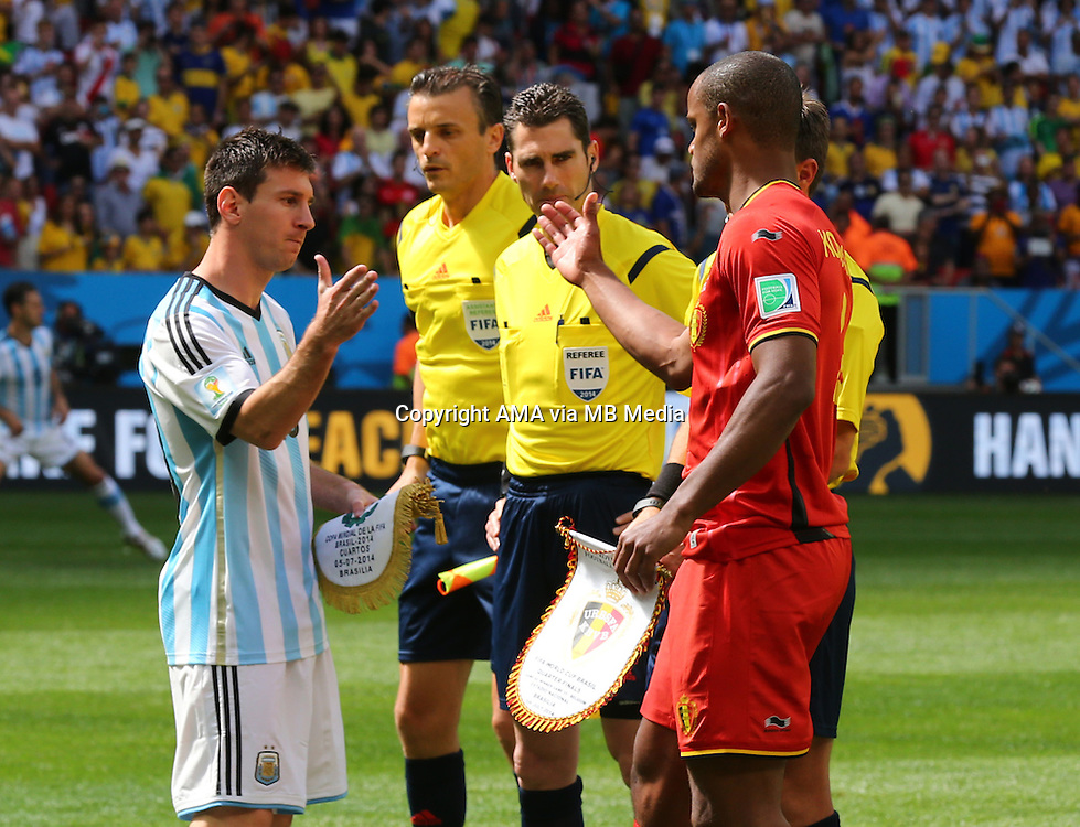 Captain Lionel Messi of Argentina shakes hands with Vincent Kompany of Belgium