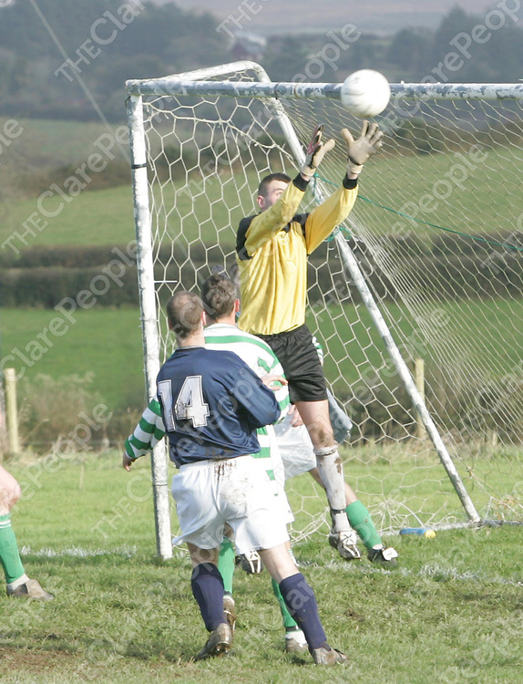 Action from the clash between Bridge Celtic and Mountshannon Celtic at Scariff on Sunday shows Bridge Celtic keeper easily catching an incoming corner ball as Mountshannons' Padraig Brody (14) looks on.<br />