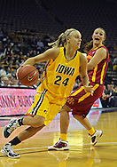 December 09 2010: Iowa guard Jaime Printy (24) drives with the ball during the first half of their NCAA basketball game at Carver-Hawkeye Arena in Iowa City, Iowa on December 9, 2010. Iowa defeated Iowa State 62-40 in the Hy-Vee Cy-Hawk Series rivalry game.