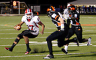 Seniors Ryan Sedlar (85) and Justin Nelson (9) persue junior Javon Harrison (17) as the Wayne Warriors play the Beavercreek High School Beavers at the Frank Zink Field in Beavercreek, Friday, October 7, 2011.