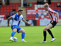 James Clarke of Bristol Rovers is challenged by George McLennan of Cheltenham Town - Mandatory by-line: Neil Brookman/JMP - 25/07/2015 - SPORT - FOOTBALL - Cheltenham Town,England - Whaddon Road - Cheltenham Town v Bristol Rovers - Pre-Season Friendly