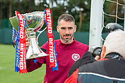 Michael Smith (#2) of Heart of Midlothian FC poses for a photograph with the Betfred Scottish Football League Cup, ahead of the quarter-final match against Aberdeen, at Oriam Sports Performance Centre, Heriot Watt University, Edinburgh Scotland on 24 September 2019. Picture by Malcolm Mackenzie