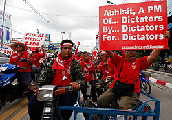 Thai red shirt protestors ride on motobikes towards the ASEAN summit venue of the Pattaya Exhibition and Convention Hall (PEACH) demanding the current government step down, on the first day of the Association of South East Asian Nations (ASEAN) plus six summit, in Pattaya, Thailand, about 160 km south east of Bangkok, Thailand, 10 April 2009. Thailand hosts the ASEAN plus three and six summits including leaders of China, Japan, South Korea, India, Australia, and New Zealand, with South East Asian leaders, from April 10 to 12.
