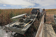 Launching a duck boat during a Manitoba waterfowl hunt.