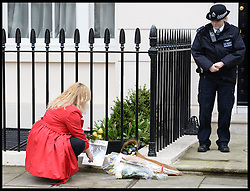 People pay their respect outside the residence of Baroness Thatcher in Chester Square, London, UK, Tuesday 9 April, 2013, after her death on Monday April 8, 2013. Photo By Andrew Parsons / i-lmages.