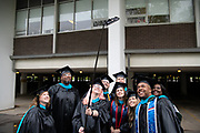 Voinovich School of Leadership and Public Affairs students take a selfie at gradute commecnement. Photo by Ben Siegel