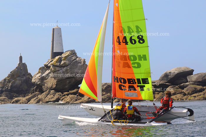 Catamaran practice in some french sailing centres / watersports centers. A catamaran is a type of multihulled boat or ship consisting of two hulls joined by some structure. Children are learning there how to make sailing on catamarans. In Brittany, France.
