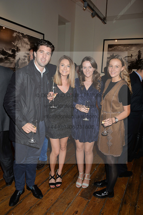 Left to right, CHRISTOPHER DODDS, LUCY YARROW niece of David Yarrow, ALISON MacLELLAN and EMILY BULL at a private view of photographs by renowned wildlife photographer David Yarrow in aid of TUSK entitled 'Wild Encounters' held at Somerset House on 19th September 2016.