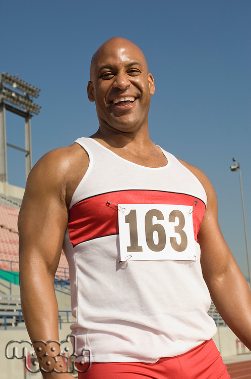 Portrait of laughing runner on a track