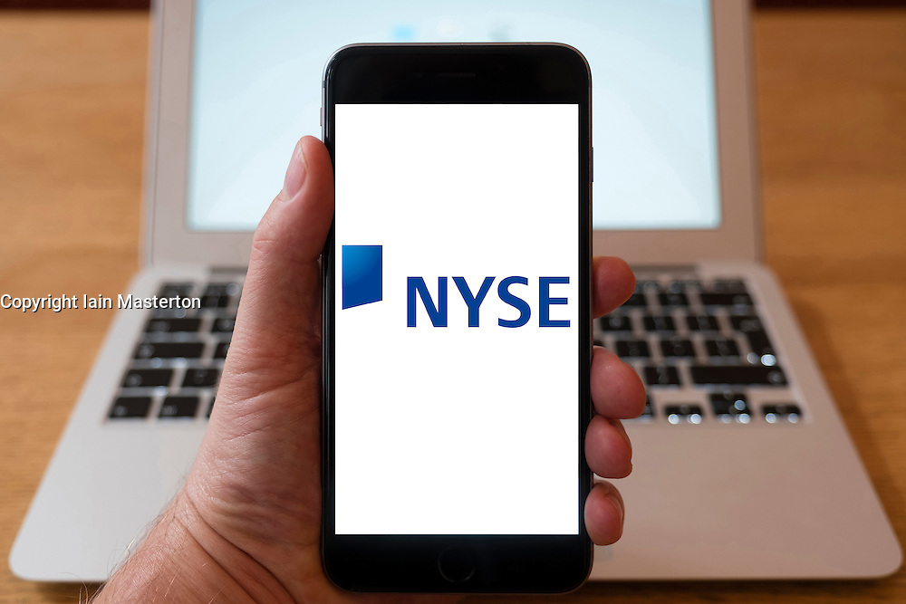Using iPhone smartphone to display logo of New York Stock Exchange, NYSE