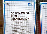 National Health Service NHS government information Coronavirus notice glass door entrance to GP surgery, Alderton, Suffolk, England, UK, -15 March 2020