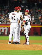 June 14 2011; Phoenix, AZ, USA; Arizona Diamondbacks pitching coach Charles Nagy (50) talks with starting pitcher Josh Collmenter (55) and catcher Miguel Montero (26) while playing against the San Francisco Giants at Chase Field. Mandatory Credit: Jennifer Stewart-US PRESSWIRE.