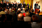 The President of the United States, Barack Obama, signs into law improved rights for veterans.