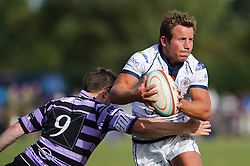 Bristol replacement Scrum-Half James Grindal is tackled by Clifton Scrum-Half (#9) Steve Uren - Photo mandatory by-line: Rogan Thomson/JMP - Tel: Mobile: 07966 386802 01/09/2013 - SPORT - RUGBY UNION - Station Road, Cribbs Causeway, Bristol - Clifton RFC v Bristol Rugby - Pre Season Friendly.