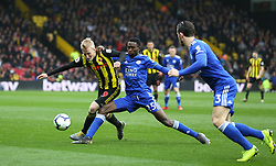 Watford's Will Hughes (left) and Leicester City's Wilfred Ndidi battle for the ball during the Premier League match at Vicarage Road, Watford.