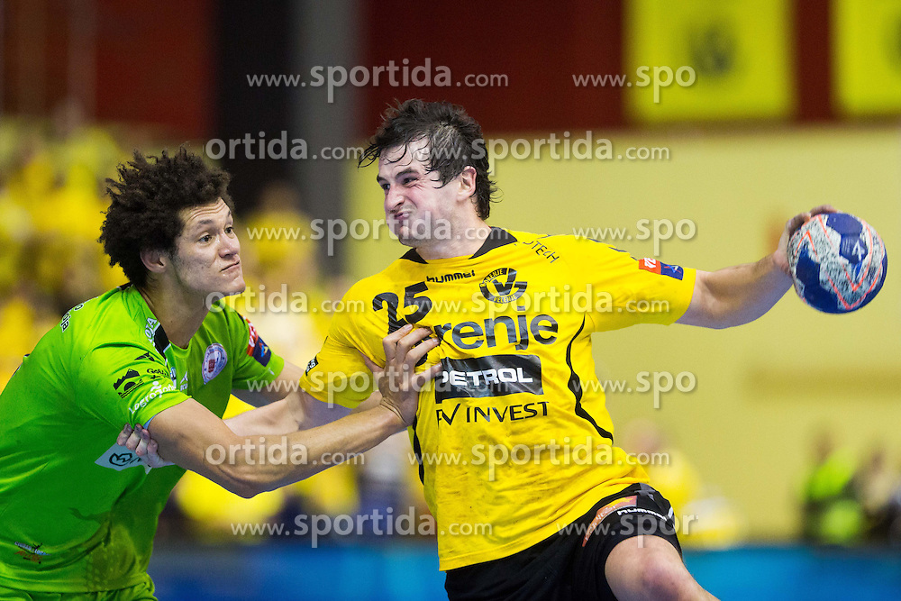 Goncalves Dos Santos Thiagus Petrus of Naturhouse La Rioja vs Jernej Papez of Gorenje during handball match between RK Gorenje Velenje and Naturhouse La Rioja in Round 6 of Group D of EHF Men's Champions League 2013/14, on November 23, 2013 in Rdeca dvorana, Velenje, Slovenia. Photo by Vid Ponikvar / Sportida