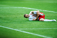 Lublin, Poland - 2017 June 16: Pawel Dawidowicz from Poland U21 injured lies on the pitch while Poland v Slovakia match during 2017 UEFA European Under-21 Championship at Lublin Arena on June 16, 2017 in Lublin, Poland.<br /> <br /> Mandatory credit:<br /> Photo by © Adam Nurkiewicz / Mediasport<br /> <br /> Adam Nurkiewicz declares that he has no rights to the image of people at the photographs of his authorship.<br /> <br /> Picture also available in RAW (NEF) or TIFF format on special request.<br /> <br /> Any editorial, commercial or promotional use requires written permission from the author of image.