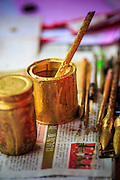 "22 JANUARY 2013 - BANGKOK, THAILAND:    A detail photo of a calligrapher's tools at his table on Charoen Krung Road in Bangkok's Chinatown district. Chinese New Year is not an official public holiday in Thailand, but it is one the biggest celebrations in the Bangkok, which has a large Chinese population. Chinese New Year is February 10 this year. It will be the ""Year of the Snake.""   PHOTO BY JACK KURTZ"