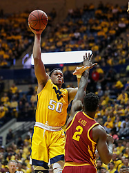 Feb 24, 2018; Morgantown, WV, USA; West Virginia Mountaineers forward Sagaba Konate (50) shoots a hook shot during the second half against the Iowa State Cyclones at WVU Coliseum. Mandatory Credit: Ben Queen-USA TODAY Sports