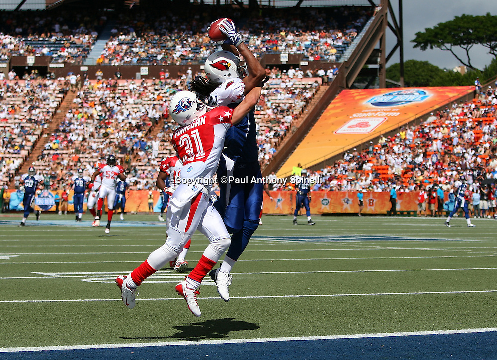 HONOLULU, HI - FEBRUARY 08: NFC All-Stars wide receiver Larry Fitzgerald #11 of the Arizona Cardinals goes airborne to catch a 46 yard touchdown pass in the second quarter while covered by cornerback Cortland Finnegan #31 of the Tennessee Titans of the AFC All-Stars in the 2009 NFL Pro Bowl at Aloha Stadium on February 8, 2009 in Honolulu, Hawaii. The NFC defeated the AFC 30-21. ©Paul Anthony Spinelli *** Local Caption *** Larry Fitzgerald;Cortland Finnegan