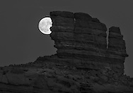 "In November of 2016 the full moon was closer to the earth than it had been for many years or would be for many to come. Here the ""super moon"" is seen rising behind a sandstone outcropping."