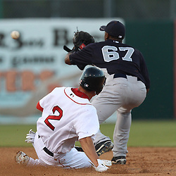 March 14, 2011; Fort Myers, FL, USA; Boston Red Sox left fielder Jacoby Ellsbury (2) is forced out by New York Yankees second baseman Eduardo Nunez (67) during a spring training exhibition game at City of Palms Park.   Mandatory Credit: Derick E. Hingle