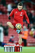 Liverpool midfielder Adam Lallana (20) warming up during the Premier League match between Liverpool and Everton at Anfield, Liverpool, England on 4 December 2019.