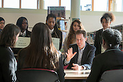 © Licensed to London News Pictures. 06/03/2015. London, UK. Nick Clegg talks with students. Deputy Prime Minister and Leader of the Liberal Democrats NICK CLEGG  and Hornsey and Wood Green MP LYNNE FEATHERSTONE visit Hornsey School for Girls today, 6th March 2015, as part of the schools work surrounding International Women's Day (March 9th). They watched a presentation by pupils on FGM, visited a careers stand promoting careers where women are under-represented and took part in a Q&A about women in politics. Photo credit : Stephen Simpson/LNP