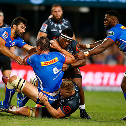 Daniel Du Preez and Phendulani Buthelezi of the Cell C Sharks tackling Eben Etzebeth of the DHL Stormers during the Super Rugby match between Cell C Sharks and DHL Stormers at Jonsson Kings Park on March 02, 2019 in Durban, South Africa. (Photo by Steve Haag)