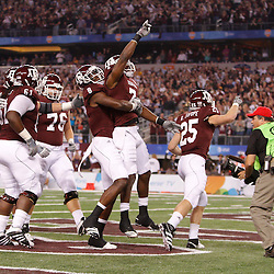 Jan 7, 2011; Arlington, TX, USA; Texas A&M Aggies wide receiver Uzoma Nwachukwu (7) celebrates with teammates following a touchdown during the first quarter of the 2011 Cotton Bowl against the LSU Tigers at Cowboys Stadium.  Mandatory Credit: Derick E. Hingle