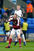 Northampton Towns Matthew Taylor (31) and Bolton Wanderers Josh Vela (6) during the EFL Sky Bet League 1 match between Bolton Wanderers and Northampton Town at the Macron Stadium, Bolton, England on 18 March 2017. Photo by Craig Galloway.