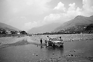 A car is stranded while trying to cross water that is only slowly receding in Mingora. Until last year militants housed in this area, but now nature has taken its course as flood waters have swept away lives and livelihoods. Mingora, Pakistan, 2010