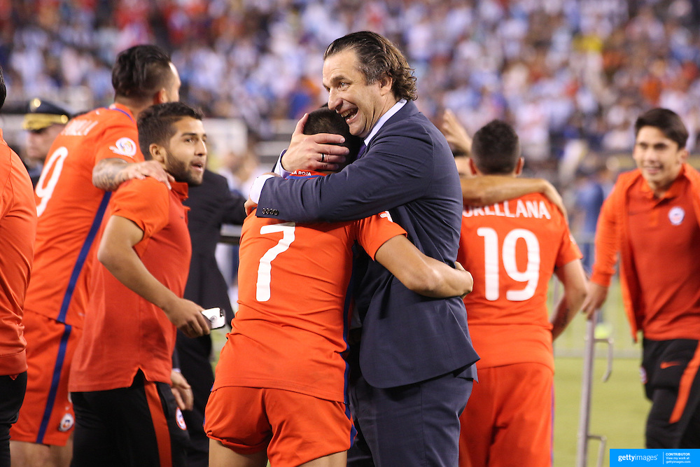 EAST RUTHERFORD, NEW JERSEY - JUNE 26: Chile national football team manager Juan Antonio Pizzi hugs Alexis Sanchez #7 of Chile after their sides penalty shoot out victory during the Argentina Vs Chile Final match of the Copa America Centenario USA 2016 Tournament at MetLife Stadium on June 26, 2016 in East Rutherford, New Jersey. (Photo by Tim Clayton/Corbis via Getty Images)