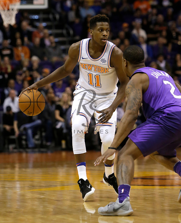 New York Knicks guard Frank Ntilikina (11) in the first half during an NBA basketball game against the Phoenix Suns, Friday, Jan. 26, 2018, in Phoenix. (AP Photo/Rick Scuteri)