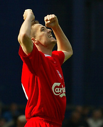 LIVERPOOL, ENGLAND - Saturday, April 19, 2003: Liverpool's Michael Owen celebrates victory at the final whistle against Everton's during the Merseyside Derby Premiership match at Goodison Park. (Pic by David Rawcliffe/Propaganda)