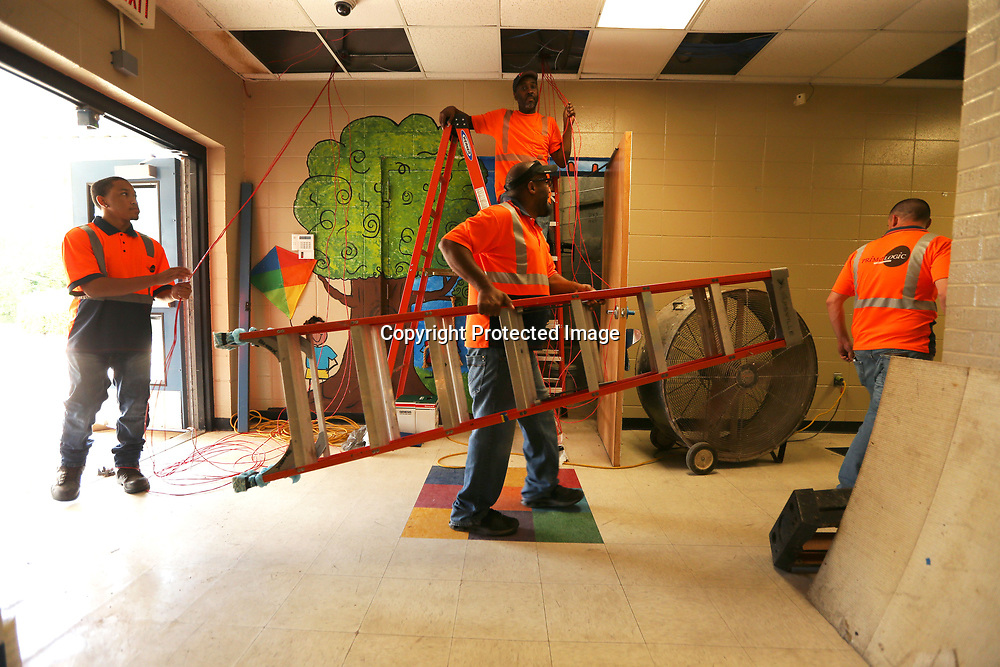 A work crew with Prime Logic, run new cables at ECEC in Tupelo for the school's telecommunication and security needs.