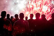 UNITED KINGDOM, Glastonbury: 22 June 2016 Revellers twatch a firework display on the first evening of Glastonbury Festival. Rick Findler / Story Picture Agency