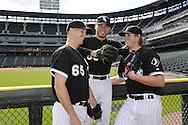 CHICAGO - APRIL 25:  Pitchers Nate Jones, Hector Santiago and Addison Reed (left to right) of the Chicago White Sox pose for a photo prior to the game against the Tampa Bay Rays on April 25, 2013 at U.S. Cellular Field in Chicago, Illinois.  (Photo by Ron Vesely)  Subject:    Nate Jones; Hector Santiago; Addison Reed
