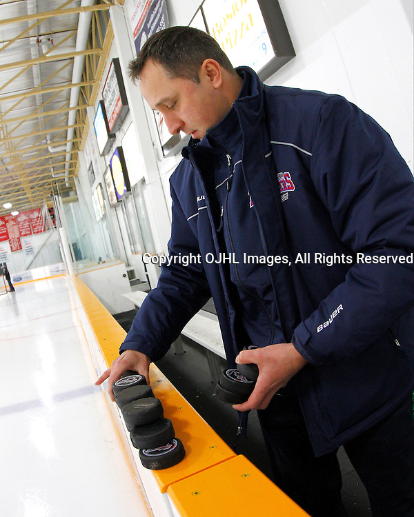 STOUFFVILLE, ON - Jan 23 : Ontario Junior Hockey League Game Action between the North York Rangers and the Stouffville Spirit, North York Rangers Hockey Club Equipment Manager Derek Eckensviller prepares the pucks for warm-up.<br /> (Photo by Brian Watts / OJHL Images)