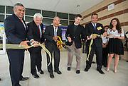 L-R: Rudy Trevino, Dr. James Benfield, Felix Fraga, Reverand Barkley S. Thomas and principal Eduardo Sindaco cut the ribbon during The Rusk School ribbon cutting ceremony, April 7, 2014.