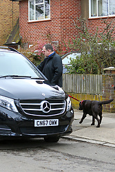 A man takes a chocolate labrador from the Chiswick, West London former home of Ant McPartlin, where Lisa McPartlin (Lisa Armstrong) his estranged wife lives. The dog was loaded into a black Mercedes people carrier. Ant of TV duo Ant and Dec was arrested on March 18th 2018 on suspicion of drink-driving  following a road accident in Richmond, in which a young girl was hospitalised. London, March 19 2018.