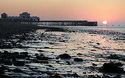 © Licensed to London News Pictures. 01/10/2015. Southsea, Hampshire, UK. Sunrise over Southsea Pier in Portsmouth this morning, 1st October 2015, on what is set to be another dry and fine day in the south of England. Photo credit : Rob Arnold/LNP
