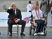 CENTRAL LONDON Boris Johnson (L) and Daniel Bentley. To celebrate two years to go until the 2012 Paralympic Games begin in London, the Mayor and Paralympians try their hand at the unique Paralympic sport of Boccia.  Played on a full size Boccia court in Trafalgar Square,the game, similar to bowls, was created especially for athletes with severe disabilities. .  23 August 2010. STEPHEN SIMPSON..